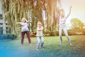 Female members of family playing with hula hoop